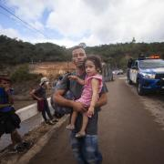 Migrants hoping to reach the distant U.S. border walk along a highway in Guatemala