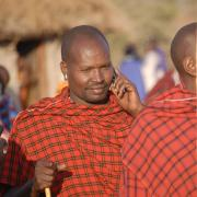 A Maasai person receives a call on his mobile phone.