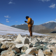 Archaeologist and paleoenvironmental researcher Isaac Hart of the University of Utah surveys a melting ice patch in western Mongolia