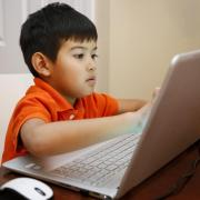 Child working on laptop computer