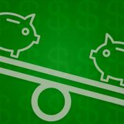 Two piggy banks on an unbalanced scale