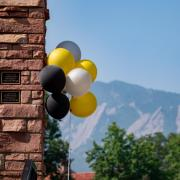 Black, gold and silver balloons