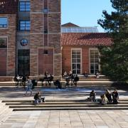 Students sit on steps outside the UMC