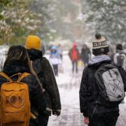 Students walking on snowy campus