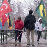 Students raise international flags on campus for Conference on World Affairs