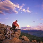 Person and bike on top of Flagstaff Mountain overlooking Boulder