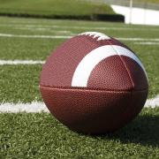 American football on green football field