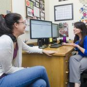 Academic advisor meets with student