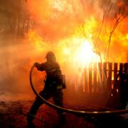 a firefighter extinguishing a blaze in California