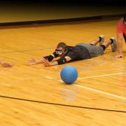 Two players in eyeshades play goalball