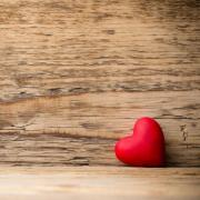 red painted heart with rustic wood background