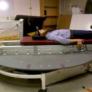 Torin Clark riding an artificial gravity simulator.