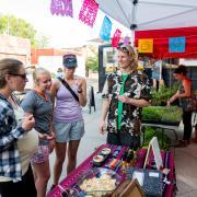 Charlie visits with customers at Boulder Farmer's Market