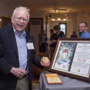 John 'Jan' Hall poses with Nobel Prize
