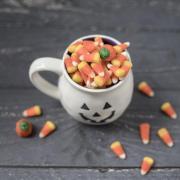 Jack-o-lantern mug filled with candy corn
