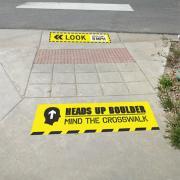 Heads Up Boulder crosswalk safety campaign sign