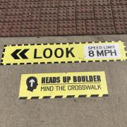 Heads Up Boulder crosswalk safety campaign sign