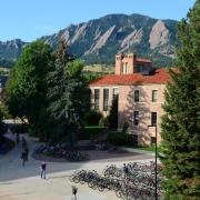 Hellems Building with the Flatirons in the background