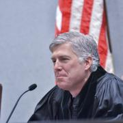 Neil Gorsuch sits at a courtroom bench. (Photo courtesy of Colorado Law.)