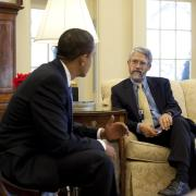 John Holdren speaks with President Obama in the White House