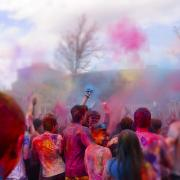Holi festival with brightly colored clay on campus