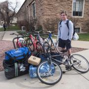 Student with luggage and bike.