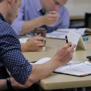 Employees take a manager's course for professional development.