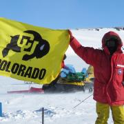Brian Hynek with CU Boulder flag