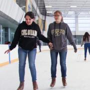 Families ice skating at the CU Boulder Rec Center Ice Rink