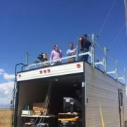 Greg Rieker, project with team members while atop their mobile laboratory in rural Colorado