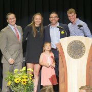 Kennedy Leonard (second from left) and Wilson Belk (far right) accept their Sports Performance Awards from strength coaches Adam Ringler and Steve Englehart.