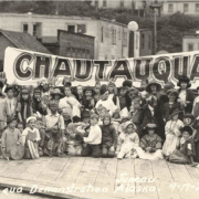 A 1921 photo of children with a large Chautauqua sign