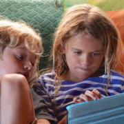 Two children with an ipad.