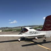 an airplane on the runway at boulder municipal airport