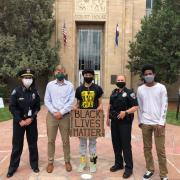CU Police Chief Doreen Jokerst and other area law enforcement officials take a photo with students during Black Lives Matter march