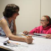 Clinician works with young girl