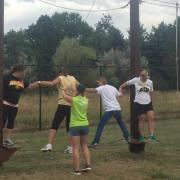 Employees participate in the UP program ropes course.