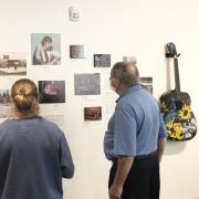 People visiting a Museum of Boulder exhibit on music