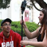 Nathaniel Nash and Rachel Boyce set up a light stand. (Photo courtesy of CMCI.)