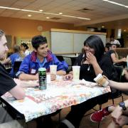 Students chat at International Coffee Hour in the UMC