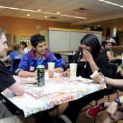 Students chat over coffee and snacks at the weekly International Coffee Hour event