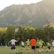 Students playing flag football outside