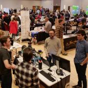Students visit various booths at the spring Involvement Fair