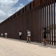 INVST students walk along the U.S.-Mexico border