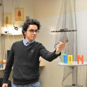 PhD student Hooman Hedayati interacts with hovering robot