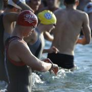 Image of swimmers standing in water.