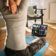 Person participates in a live virtual workout class