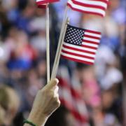 people waving small American flags