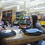 Two students talking at Norlin Library
