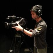 CU Boulder student Jackson Xia films for his job at CU Presents